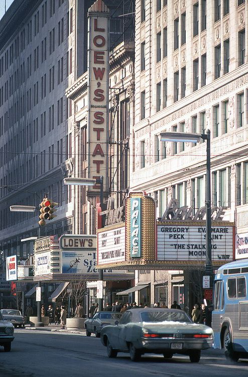 A downtown theatre 1968 judging by the movie. Anyone recognize the city?