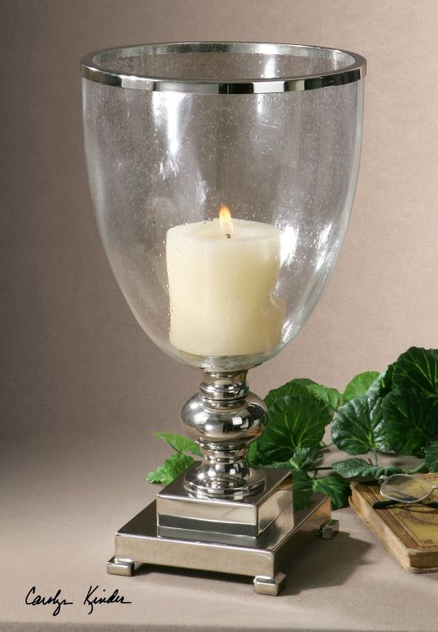 Uttermost Lino Candleholder. Nickel plated, metal base and accents with clear glass globe and distressed beige candle.