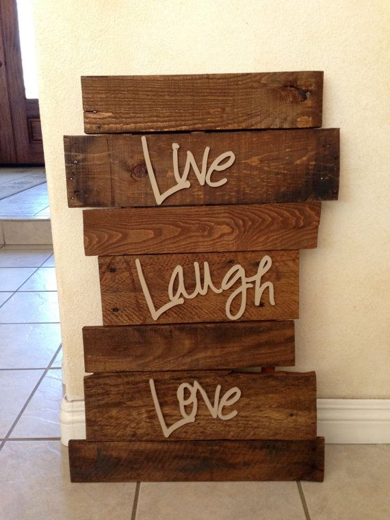 Hey, I found this really awesome Etsy listing at http://www.etsy.com/listing/166424438/pallet-sign-wall-hanging-live-laugh-love