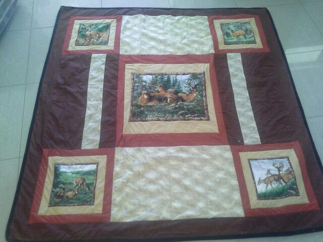 This is a deer inspired double/queen bed quilt  in versions of brown , each one of my quilts are one of  $300.00 + p+h