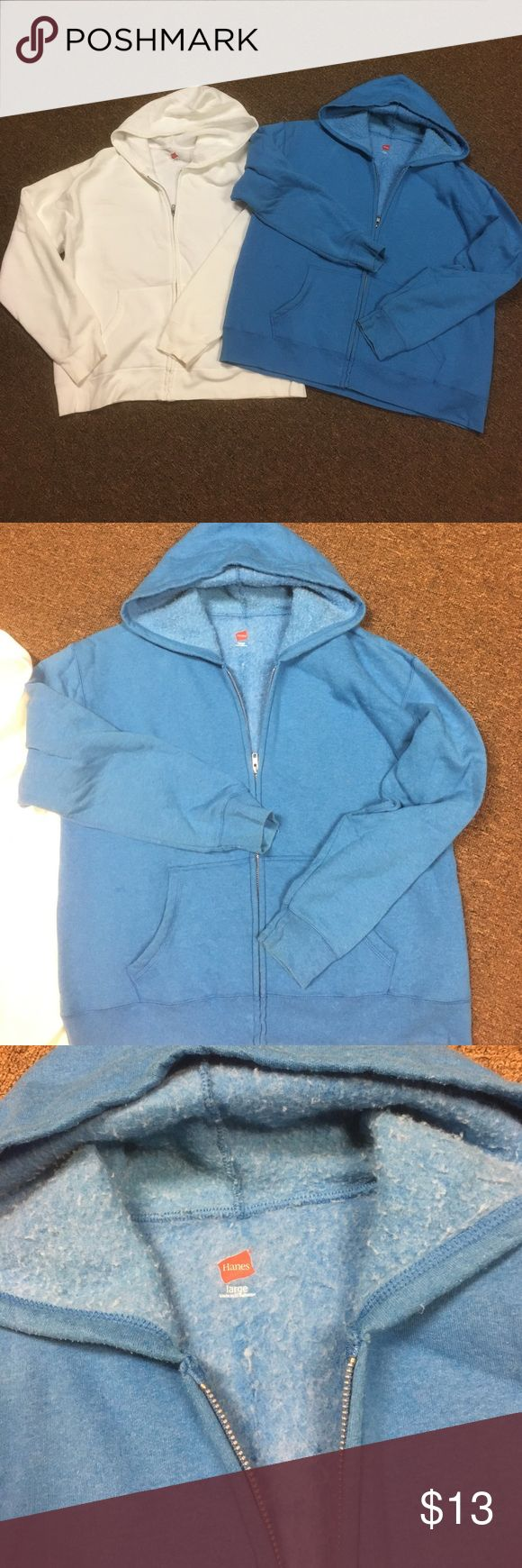 Women's Hanes Zip Up hoodies One white one blue.. white in used condition a little discolor by bottom of sleeves from sitting in my closet,blue in good condition selling as a bundle Hanes Sweaters