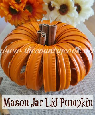 Mason Jar Lid Pumpkin. This super simple project is made of just mason jar lids, some spray paint, a little string to hold it together, and a few sticks of cinnamon for the stem.