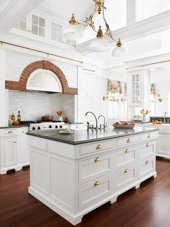 brass hardware on white cabinetry