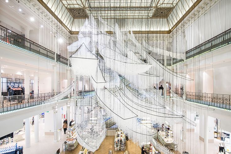 chiharu shiota @le bon marche  exhibition invites visitors to 'sail towards a fresh start' as they ponder the origin and destination of the boats, taking them on a journey of uncertainty and wonder. t