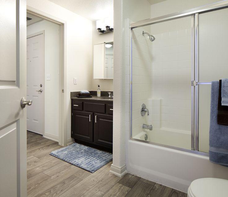 Bathroom Faux Plank Wood Ceramic Tile Flooring, White Tub