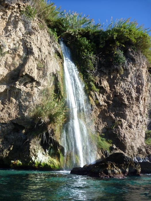 Waterfall of Maro at the protected cliff coast Acantilados de Maro-Cerro Gordo, Andalucía, Spain...