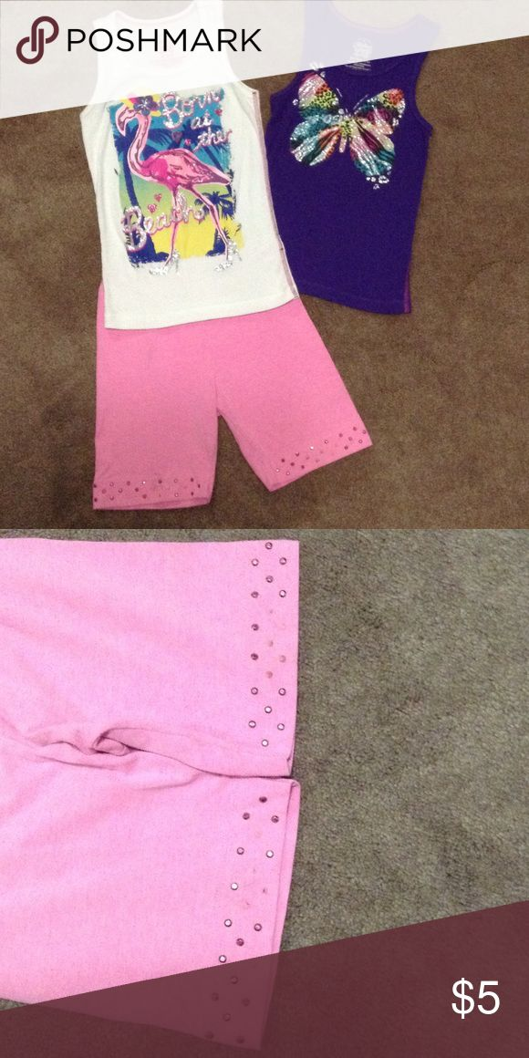 Little girls tanks and biker shorts 2 Tank tops and stretch shorts. Shorts have rhinestones on bottom. A few are missing. Shorts are size 7 Garanimals. Flamingo top size 7/8. Purple butterfly top 6/6x Shirts & Tops Tank Tops