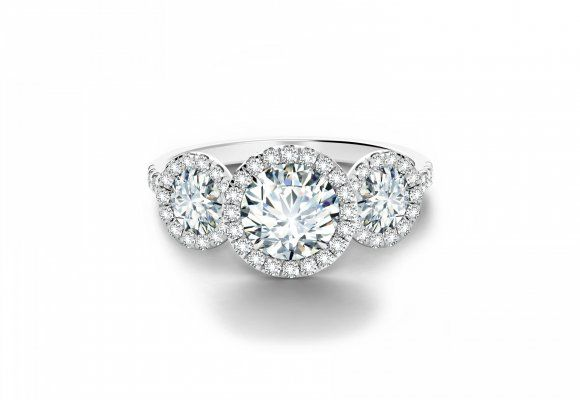 I feel like this should be an anniversary gift in my future. ;-) Round Halo Three Stone Ring