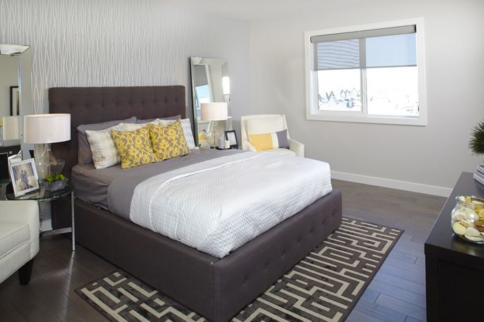 Owner's bedroom in the Tofino II showhome in Hillcrest in Airdrie by Shane Homes.