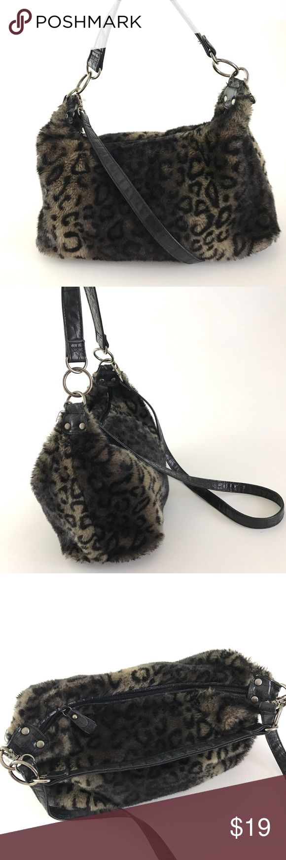 "BUENO Faux Fur Animal Print Shoulder Bag BUENO  Faux Fur Shoulder Bag Animal Pattern Purse Double Strap Handbag   Nice pre Owned Bag, in Good Shape  No Holes or Stains on Outside  No wear on Straps  Has makeup Stains on Inside Bag- Shown in Photos   Inside Bag has 2 Open Pockets   Height:9""  Width:13""  Longest Strap Drop: 25""    Item comes from a pet free/smoke free clean environment  please contact me for any additional questions  I offer combined shipping BUENO Bags Shoulder Bags"
