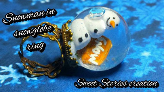 Check out this item in my Etsy shop https://www.etsy.com/listing/211737052/snowman-snowglobe-ring-snowman-miniature