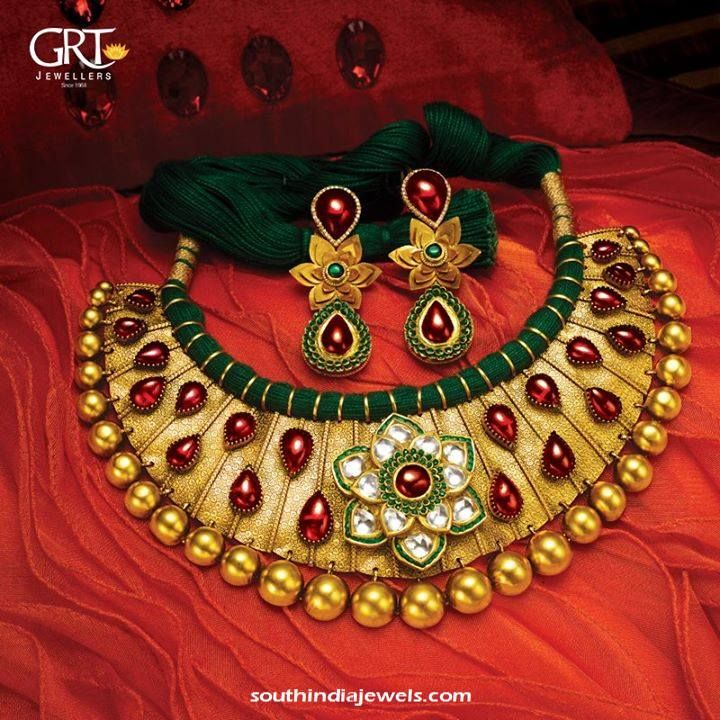 22k gold threaded choker necklace embellished with kundans, rubies and emeralds. For inquiries please contact GRT Jewellers,+914423461551.