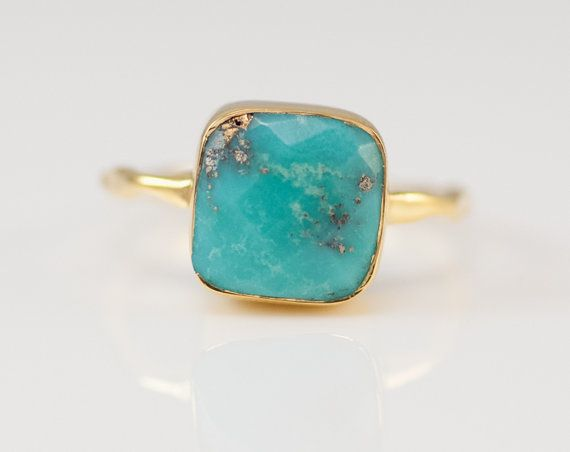 Natural Turquoise Ring. Solitaire Cushion Birthstone Ring. Available in 18K Gold Vermeil or 925 Sterling Silver. Please select size and metal option from drop down menu.  This listing is for the following 1 (ONE) ring: ✦Gemstone: Natural Turquoise *natural inclusions inside the stone ✦Stone Cut: Cushion Cut ✦Stone Size: Approximately 9mm (0.35) ✦Metal: 18K Gold Vermeil or 925 Sterling Silver  *Because we use natural stones, the stones may vary slightly in shape, size and color. *Each item is…