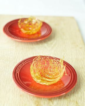 Sugar spun baskets are magical things and aren't half as difficult to make as they look. A fine web of sugar can transform the simplest of desserts into something spectacular. One caveat – watch out for the hot caramel… Ingredients: 100ml cold water 500g caster sugar 1 Tbsp glucose syrup (optional – it will help…