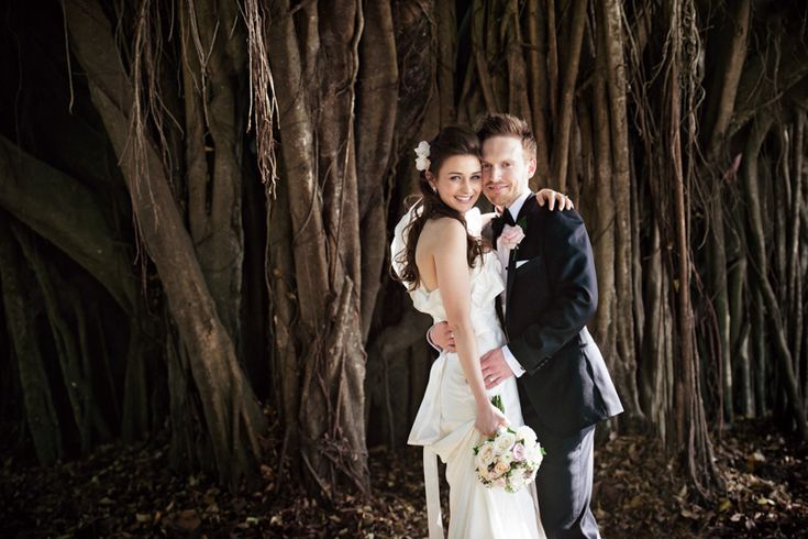 Port Douglas Wedding Photography. Byron and Elise, in amongst the fig tree at Rex Smeal Park in Port Douglas. Destination Wedding Photography.