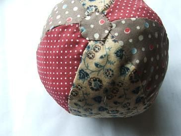 tutorial for fabric ball add rattle inside and it's emma's favorite toy!
