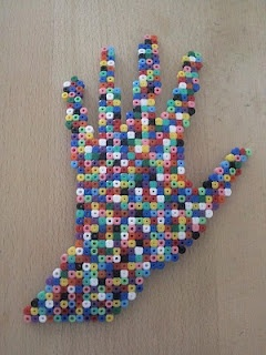 trace child's hand, place under clear fuse-bead trays, have them fill in with perler/hama beads!