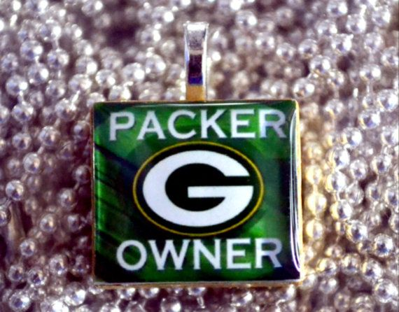 LauriginalDesigns from Etsy made this necklace for me after I saw just the Packers G she added the Packer Owner, I am a packer owner.