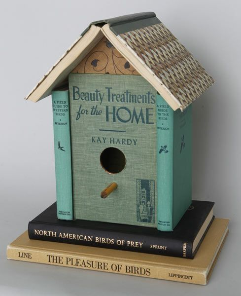 Birdhouse made from recycled books.