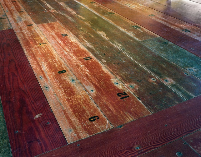In their previous life the boards were bleachers for a for Unusual flooring materials