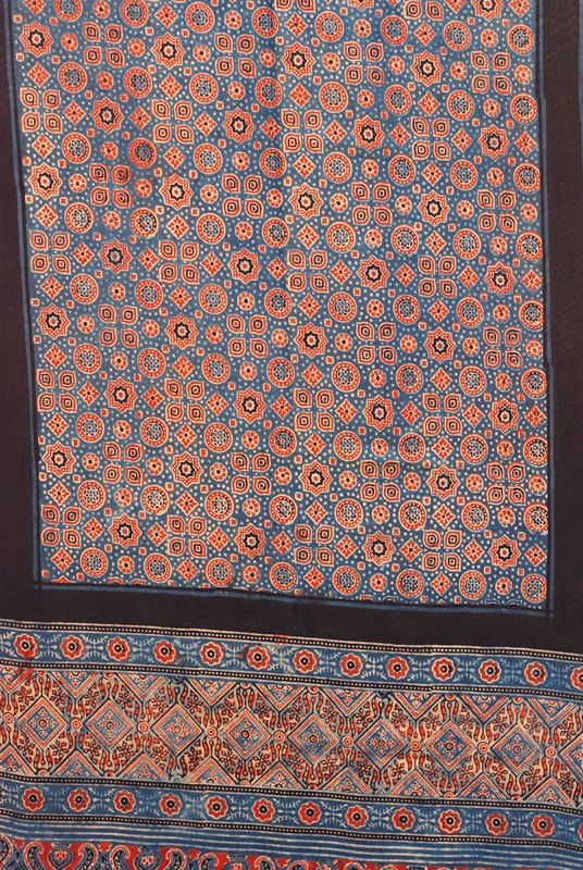 Ajrakh is a traditional vegetable dyeing and resist block-printing technique on cloth. It is estimated to be around 4,500 years old. Sindh region (now in Pakistan) is said to be the birthplace of Ajrakh. The Ajrakh artisans in India are originally from Sindh and they migrated to Kutch in Gujarat and Barmer in Rajasthan. Ajrakh is the traditional attire of the Maldhari pastoral community of Bhuj. The men wear it as a lungi (wrapped lower garment), as a turban, or put it on their shoulders.