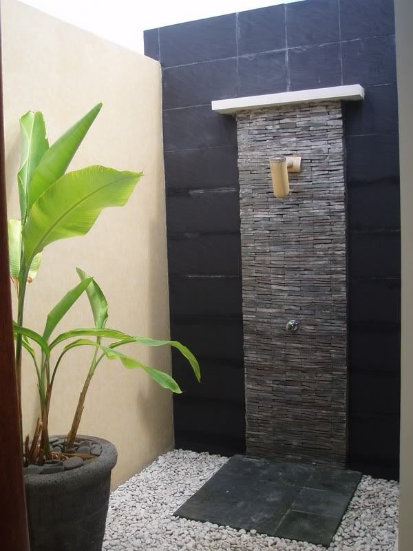 When I traveled in Bali, we stayed in a villa that had a magnificent outdoor shower/bathroom similar to this one.  I'd love to recreate the feeling of this one day with natural elements (minus the outdoor part).