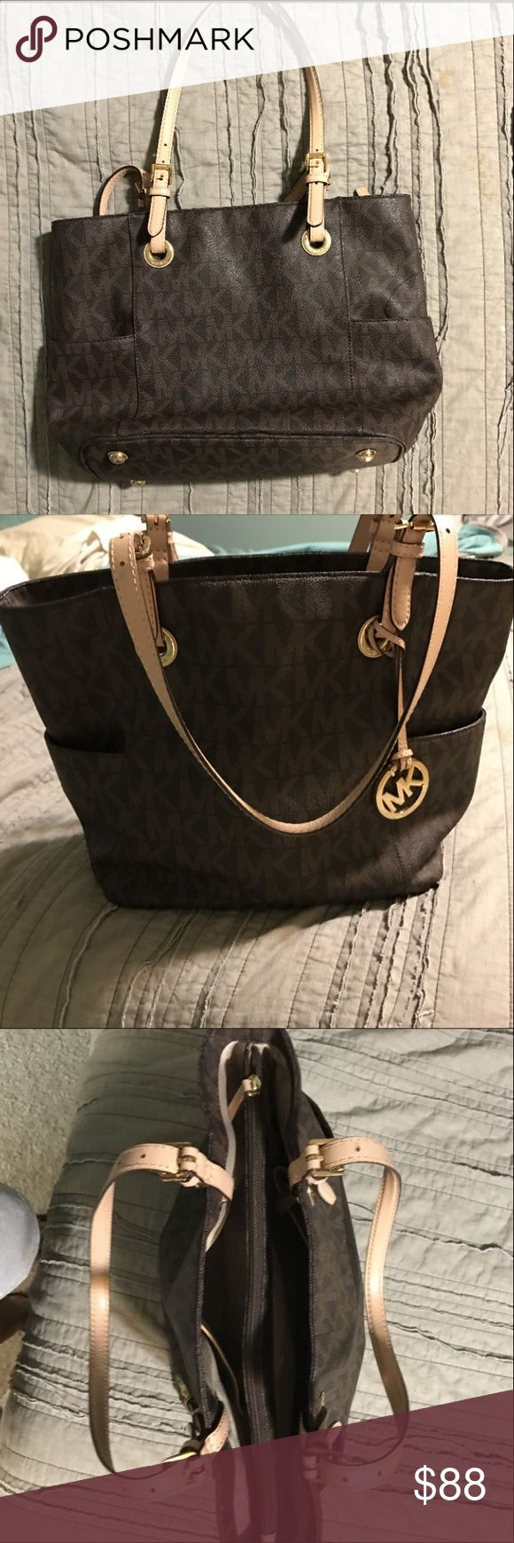 Michael Kors Jet Set Tote Great condition. One flaw- two small lipstick stains on inside of corner pocket. Michael Kors Bags Shoulder Bags