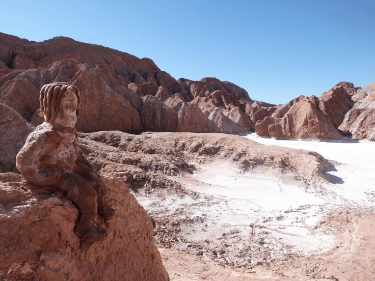 The Atacama Desert - a vast expanse forged from a thousand tiny details.  A clay man sits in the Atacama's Salt Mountains #travel #desert  www.cascada.travel