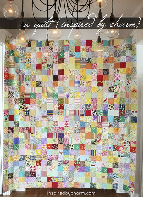 a quilt made from scraps of fabric submitted by blog followers via inspiredbycharm.com