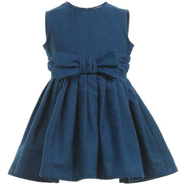 Little girls blue cotton denim dress by Il Gufo in a classic, sleeveless style with a full skirt. It has a bow attached to the front and it fastens with a concealed zip on the back. Very versatile, it can be dressed up for parties or worn everyday with or without a top underneath. <br /> <ul> <li>98% cotton, 2% elastane (soft denim)</li> <li>Hand wash</li> <li>Made in Italy </li> </ul>