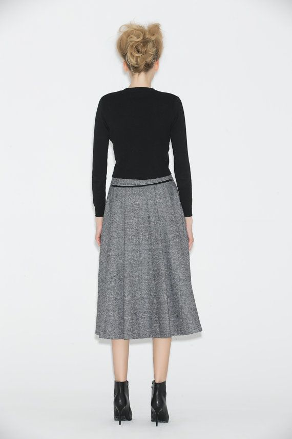 Update your skirt collection for every occasion with this seasons grey wool skirt. The shape is a must-have for any woman and will carve a feminine silhouette. Now you can refresh your everyday casuals. Crafted from soft gray marl wool, the skirt features contrasting black piping with