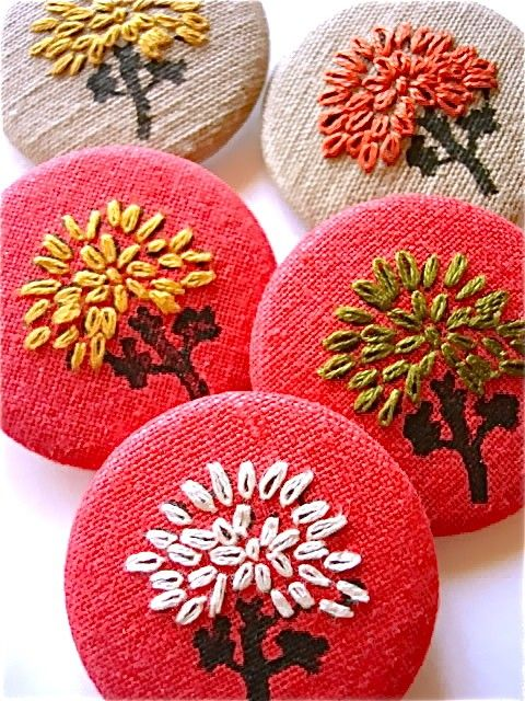 The contrasting color of the trees & background really make the embroidery pop. Hand Embroideed Cotton Fabric Flower Pin Button by IFeltItToo