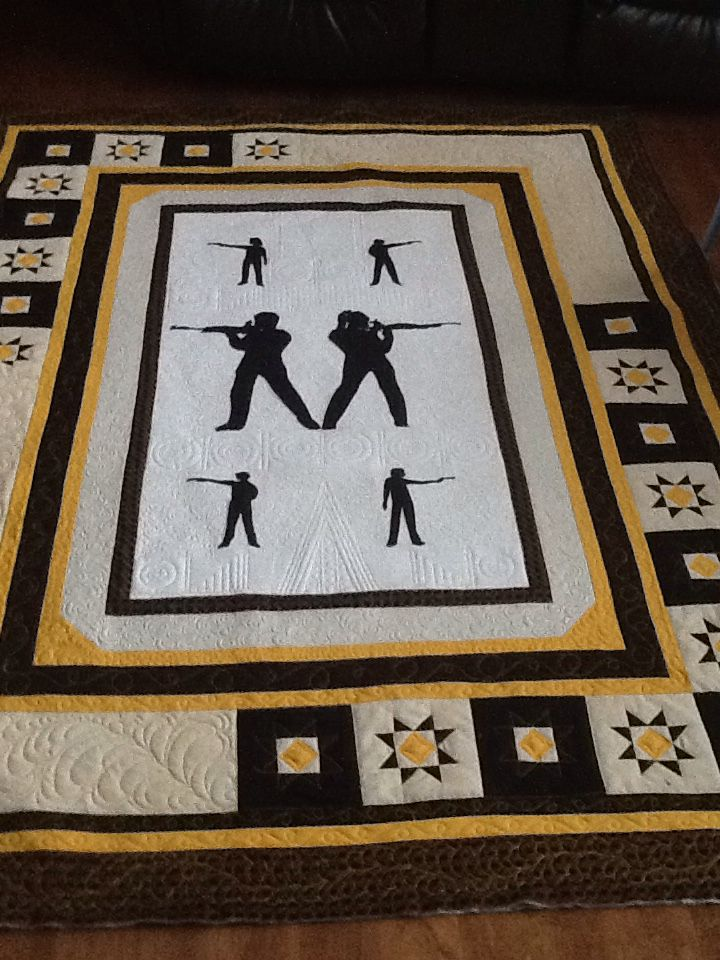 A commissioned quilt for the Rifle and Pistol club.