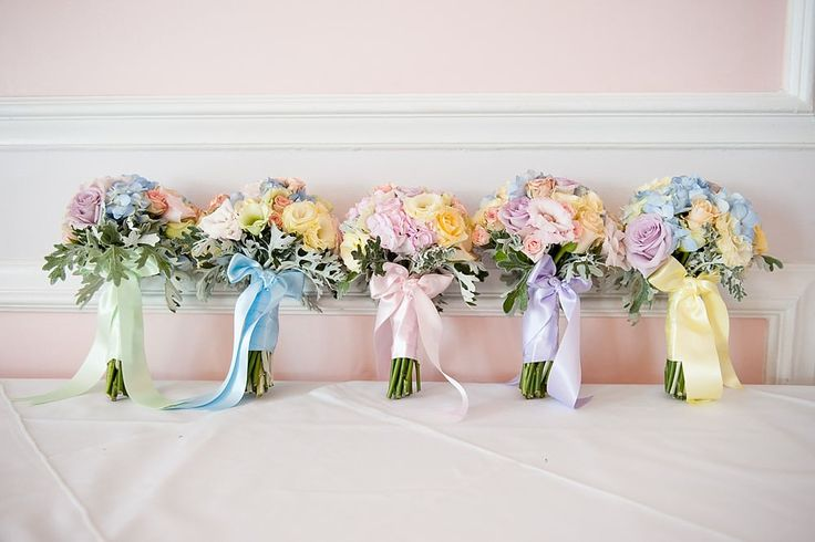 Pastel bouquet / posey with different coloured ribbon wrapped around each one -   Pastel Wedding With Ribbon Details At Hunton Park With Bride In Original Always & Forever Designed Gown And Bridesmaids In Pastel Gowns From Kelsey Rose With Groom And Groomsmen In Suits From Hugh Harris And Images By Fiona Kelly