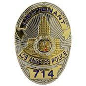"""a LAPD badge replica. """"Not if I've got the keys!"""" She inspected the badge. It was perfect- and it even featured her grade and her badge number, 714. (Ch 9)"""