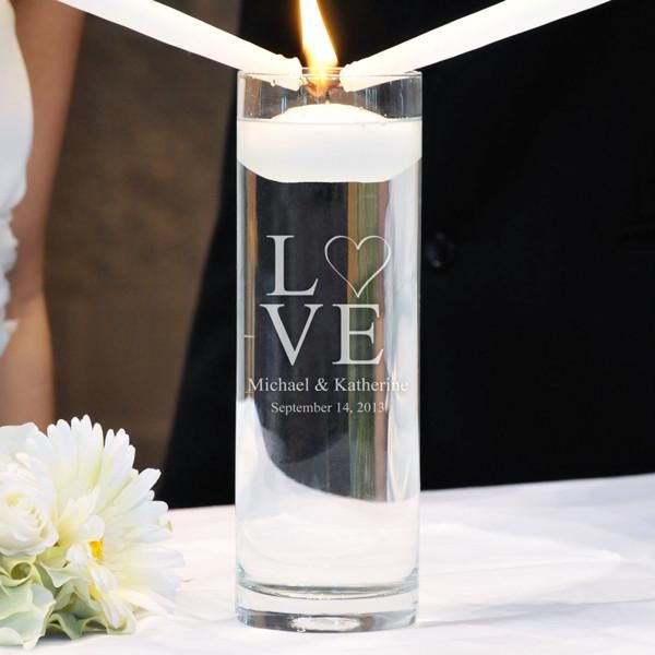 """Beautifully etched and custom designed, our Love Collection Unity Candles are an ideal solution to your wedding accessory needs. Dually crafted as wedding ceremony candles on the big day, as well as keepsake vases for your home every day after, the tailored unity candle alternatives will never go out of style.The free engraving makes this unity candle a cherished memento. Available in two designs: Modern Love (LD) and Two Hearts (HD). *Please view """"See More Photos"""" for additional design…"""