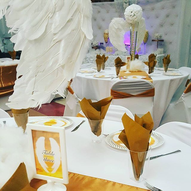 Heavenly repass. Angel wing centerpieces. White and Gold
