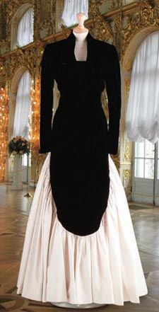 Designed by Murray Arbeid. Black velvet bodice and bolero jacket white taffeta skirt. Diana wore this gown to a fund raising event to save Britain's Wheelchair Olympics. $24,150.00 Purchased by Kate McEnroe of AMC.