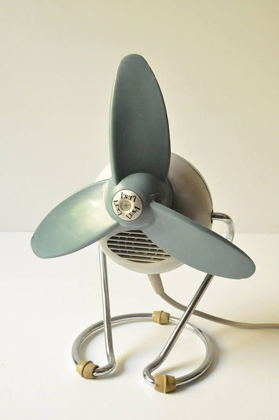 This super cute Lesa retro electric fan, was made in Italy and dates back to the early 60s. Its made of plastic except the base. Its in excellent working condition. It measures 20 cm high (7.9) from the bottom up to the on-off button.  It has a european plug but if you wish we can include an american plug adaptor, just let us know! It runs on 200-240 V for european electric system but it can also be switched to 110-130 V or 140-170 V for other electric systems. (please see photo 4)  It can…