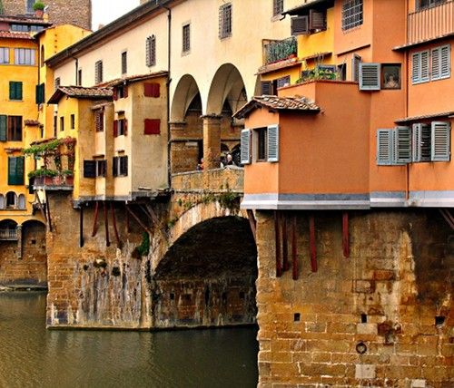 florence, italy...Ponte Vecchio (old bridge) was once used by fishermen and sea traders...now the shops sell high end jewelry and tourist trinkets