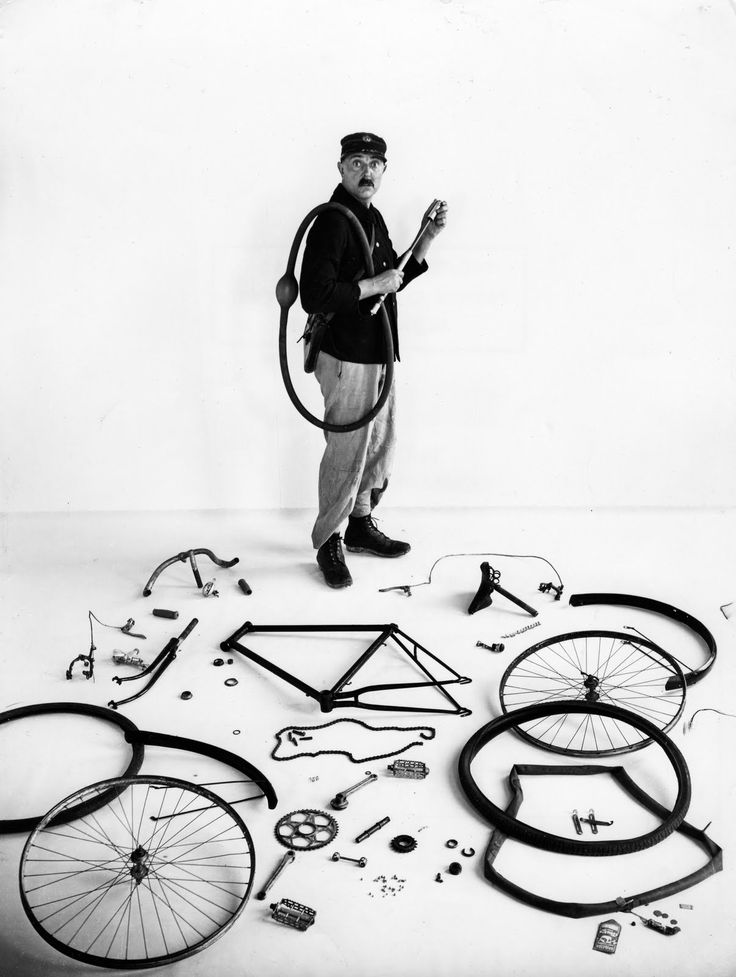 Robert DOISNEAU :: Jacques Tati [French filmmaker, comedic actor, writer and director] and dismounted bicycle, 1949