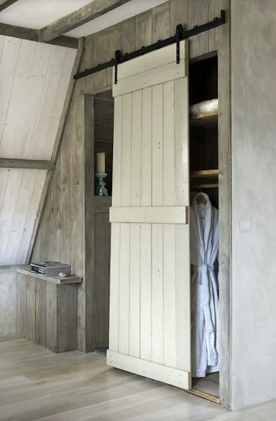 Hmmm...a barn door as a door for a closet.