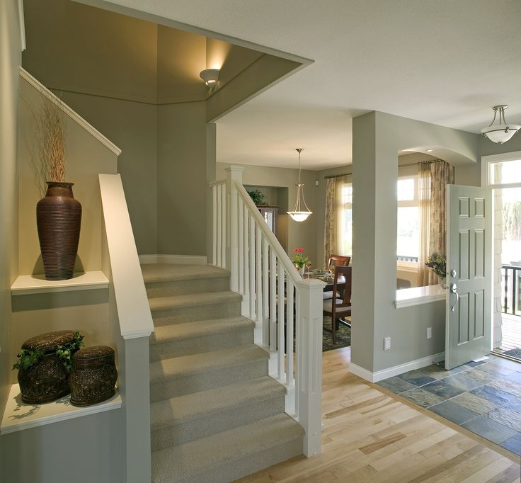 It does not get more traditional than this entry with ceramic tile leading in, white railing with rounded staircase, hardwood floors throughout and a walkway into the dining room. Does your entry look similar? Like if yes.