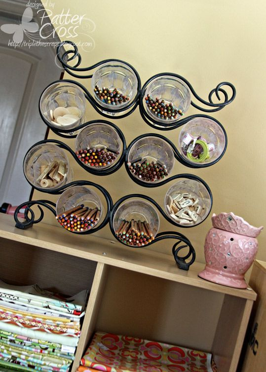 Recycle a Wine Rack into a Craft Supply Organizer by putting cups/glasses where the wine bottles go, then fill with supplies.