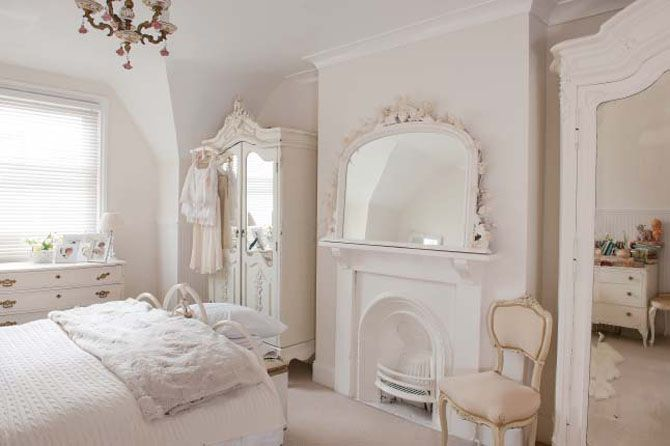 Stunning bridal inspired bedroom with crisp whites and ivory tones.