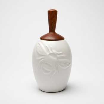Beehive Kitchenware's honey pot, porcelain base with wooden honey dipper lid.