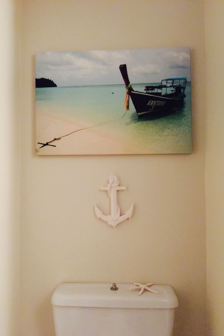 A touch of costal theme in our powder room downstairs. The canvas is our own pict from our honeymoon in Koh Samui