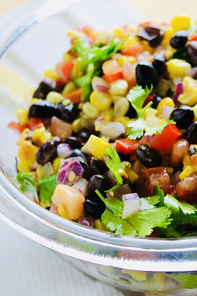 This black bean and grilled corn salad is a feast of colors, textures, and flavors. It's perfect for grilling season. Cl…