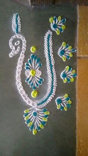 Peacock rangoli - simple but so beautiful