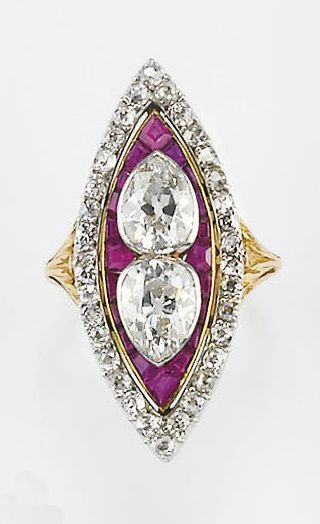 A DIAMOND AND RUBY RING, circa 1900. Navette with pears - invert for infinity sign